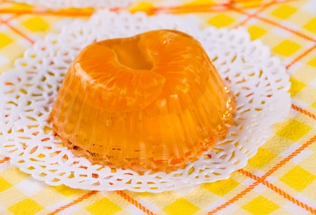 Fruit tangerine jelly on white lacy napkin Stock Photo - 17531756