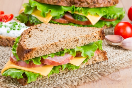 Sandwiches with ham, cheese and fresh cucumber Stock Photo - 17665266