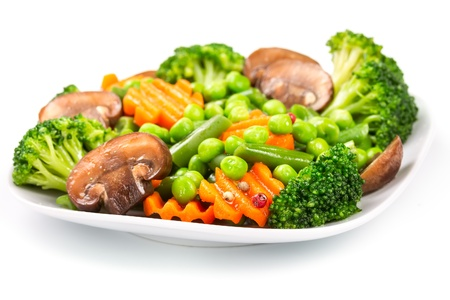 Mixed vegetables on a plate isolated on white background