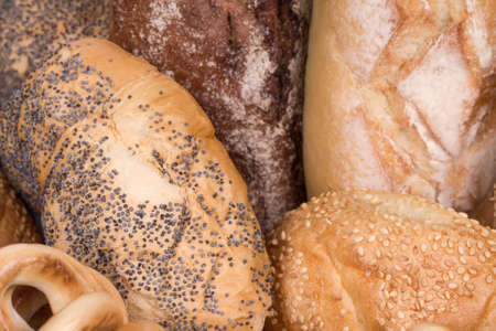 Bread, buns with sesame seeds and bagels photo