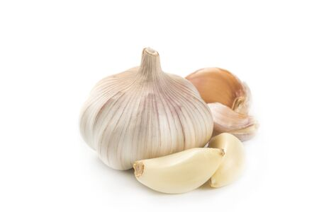 Garlic and a few slices isolated on white background