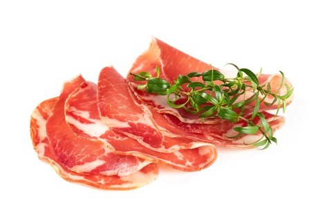thinly: Thinly sliced ham isolated on white background