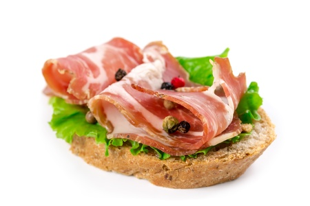 Canape with bacon isolated on white background Stock Photo