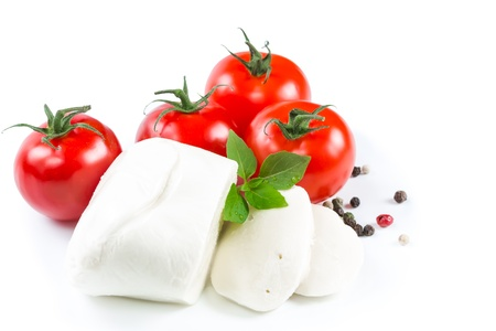 Mozzarella, tomatoes and basil leaves on white background photo