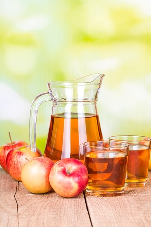 Jug and two glasses of apple juice photo