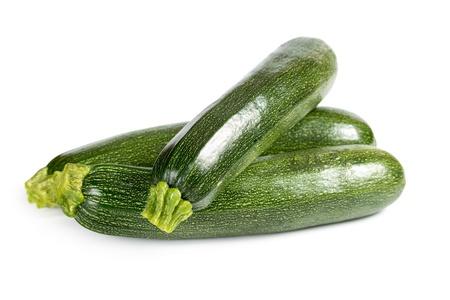 Three ripe zucchini isolated on a white background Standard-Bild