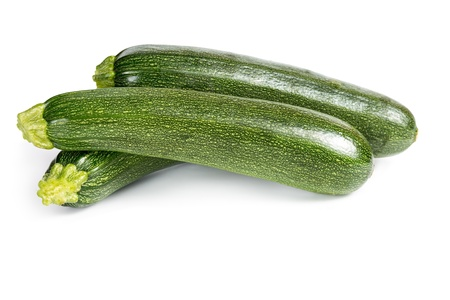 courgettes: Three ripe zucchini isolated on a white background Stock Photo