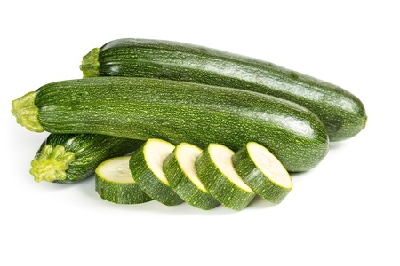 Zucchini with sliced slices isolated on white background