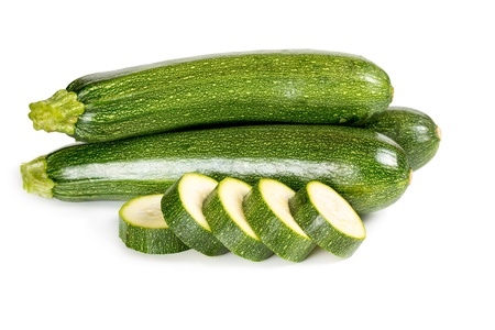 vegetable marrow: Zucchini with sliced slices isolated on white background