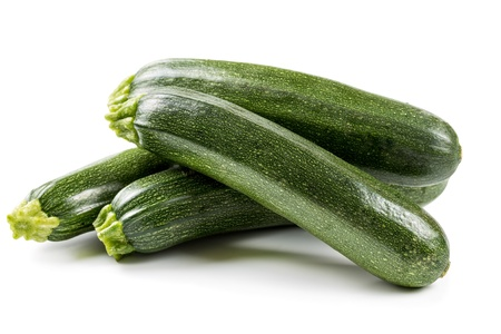 Four ripe zucchini isolated on a white background Stock Photo