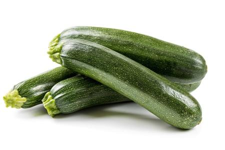 Four ripe zucchini isolated on a white background Standard-Bild