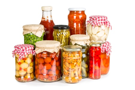 Marinated vegetables in glass jars isolated on white background Фото со стока