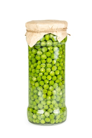 Canned green peas in glass jar isolated on white background photo