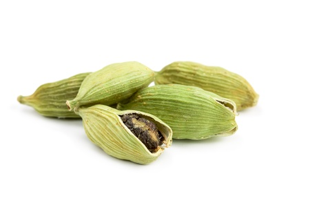Pile of whole cardamom isolated on white background