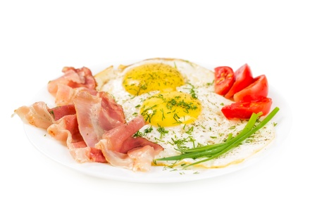 Fried eggs with bacon on a plate isolated on white background Stock Photo