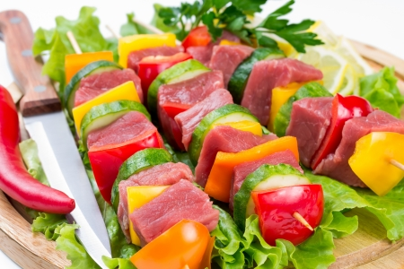 Meat on skewers with ofoschami on lettuce leaves