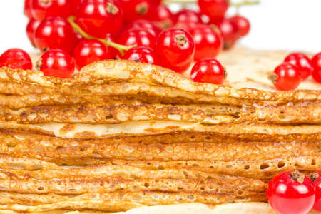 Thin pancakes with berries red currant isolated on white background photo