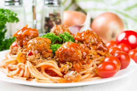 Spaghetti bolognese with beef meatballs and parsley photo