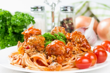 Spaghetti bolognese with beef meatballs and parsley