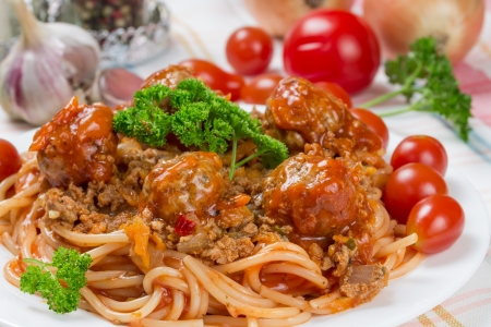 traditional Italian dish spaghetti bolognese with beef meatballs and parsley photo