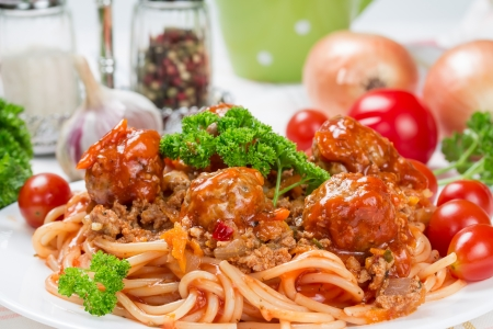 Italian dish spaghetti bolognese with beef meatballs  photo