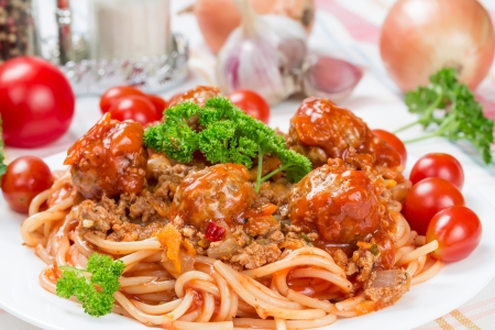 Italian dish spaghetti bolognese with beef meatballs and parsley photo