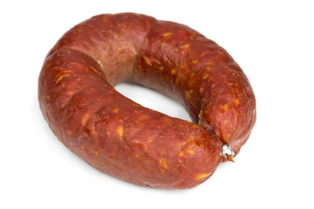 Krakow smoked sausage isolated on white background photo