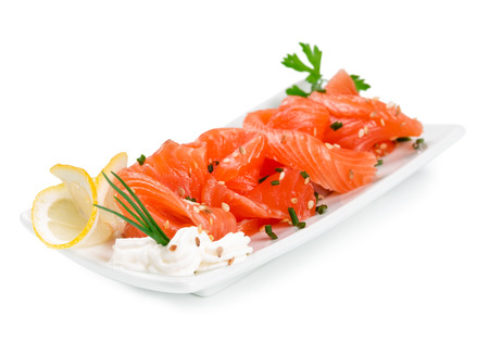 Sliced ​​salmon on a plate isolated on a white background. photo