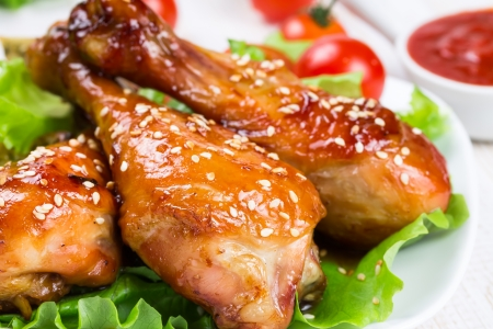Fried chicken legs with teriyaki sauce and sesame seeds
