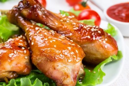 Fried chicken legs with teriyaki sauce and sesame seeds