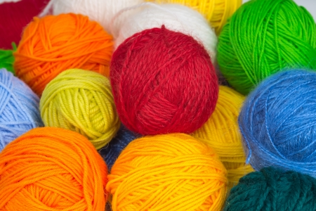 Several colorful balls of wool yarn for knitting