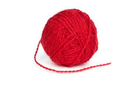 Ball of red wool yarn isolated on a white  photo