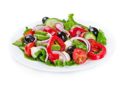 Salad with fresh vegetables isolated on white background photo