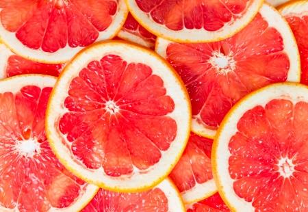 pomelo: Textura de una madura pomelo rebanada, primer Foto de archivo