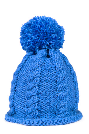 Knitted hat with a pompon isolated on white background Фото со стока