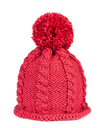 fleece fabric: Knitted hat with a pompon isolated on white background Stock Photo