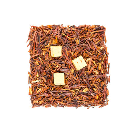 Rooibos tea with caramel isolated on white background