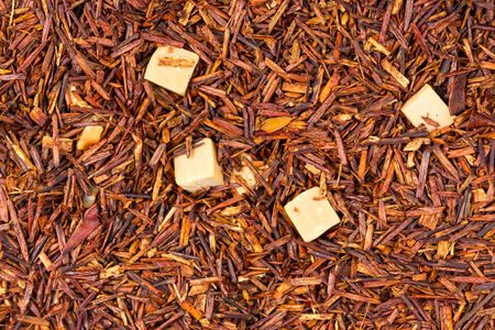 Background of Rooibos tea with caramel slices
