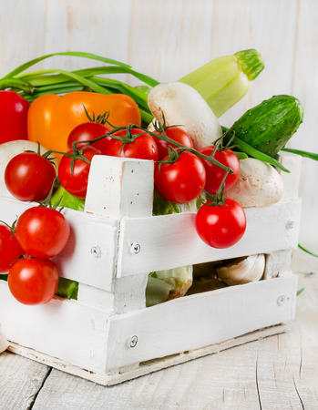 Fresh vegetables in a white painted wooden box   photo