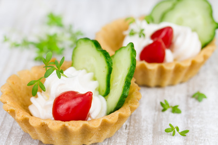 Tartlets with cream, pepper and cucumber photo