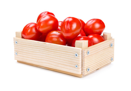 Wooden box with tomatoes isolated on white background. photo