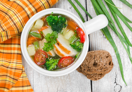 Vegetable soup with chicken white ceramic bowl