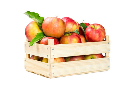 wooden box: Apples in a wooden box isolated on white background Stock Photo