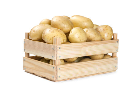 Potatoes in a wooden box isolated on white background