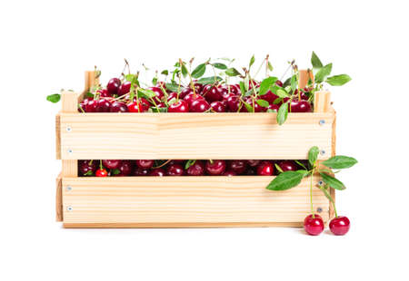 wooden box: Cherry in wooden box isolated on white background