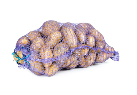 Raw potatoes in a sack isolated on white background