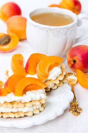 Biscuit with cream cheese and fresh apricots photo