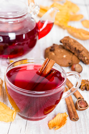 Fruit tea with cookies on wooden background photo