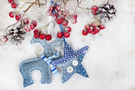 Christmas reindeer and star on a branch with berries  photo