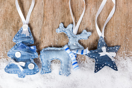 Christmas tree, reindeer and star on wooden background photo